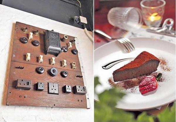 這板舊式電掣,是他去油街的政府物料供應處中收集回來的,現在成了餐廳的裝飾之一。/ 黑朱古力蛋糕 ($48)。