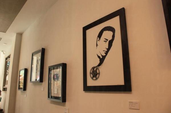 店裡展出以環保為主題的藝術品,其中有一幅以菲林製作「哥哥」張國榮畫像。